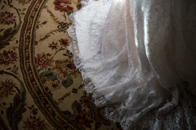 wedding dress on rug