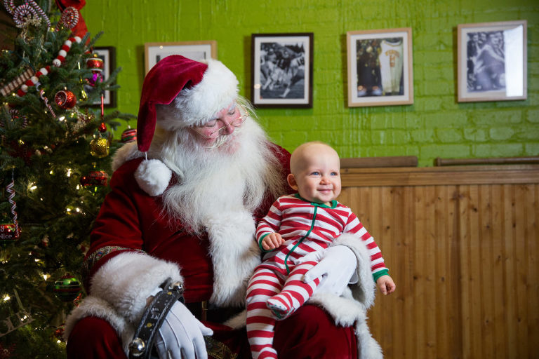 Smiling kid with Santa at Public